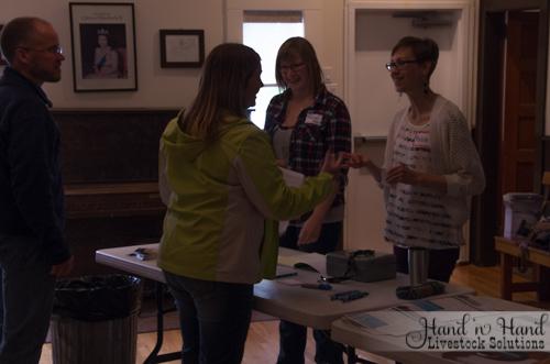 Rachel and Melisa registering attendees